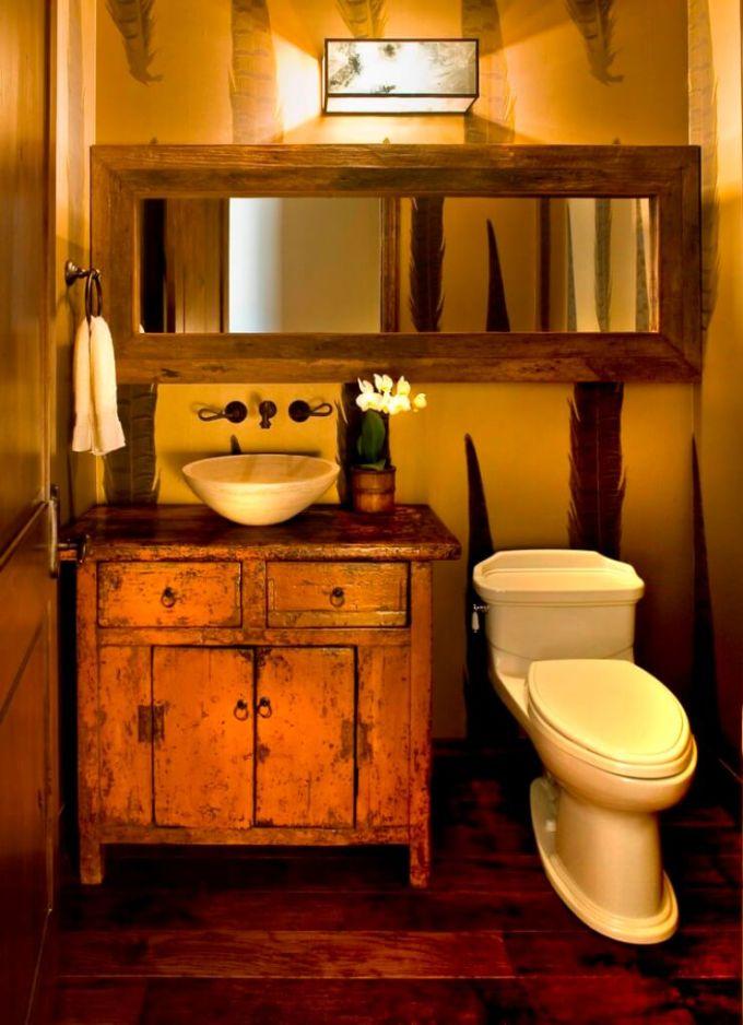 Rustic Bathroom Decor Ideas - Distressed Vanity Cabinet and Wood-framed Mirror - harpmagazine.com