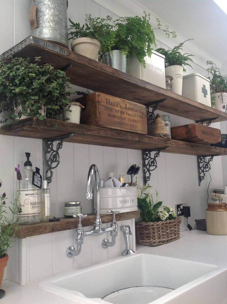 French Country Decor Ideas - Rustic Wooden Kitchen Shelves with Potted Ferns - Harpmagazine.com