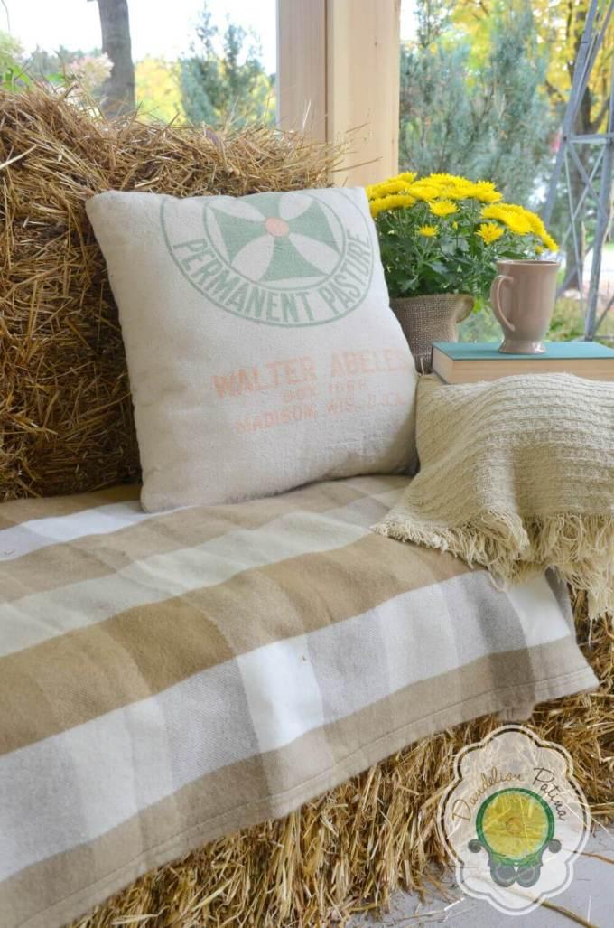 Farmhouse Porch Decorating Ideas - Cozy Haystack Stuffed Porch Sofa & Natural Throw - Harpmagazine.com
