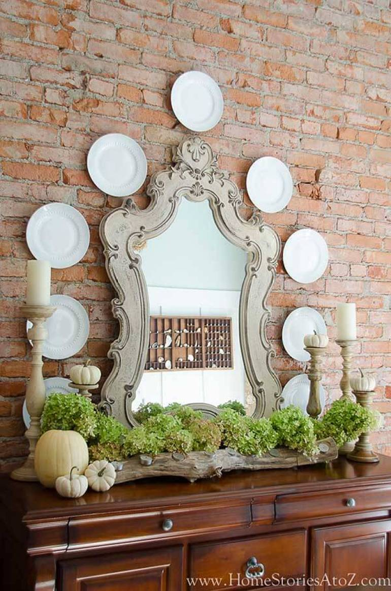 French Country Decor Ideas - Elegant Buffet Against Contrasting Exposed Brick Wall - Harpmagazine.com