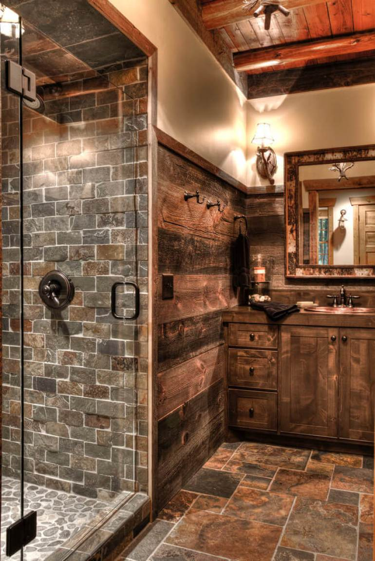 Rustic Bathroom Decor Ideas - Stone Lodge Bathroom Featuring a Camo-edged Mirror - harpmagazine.com