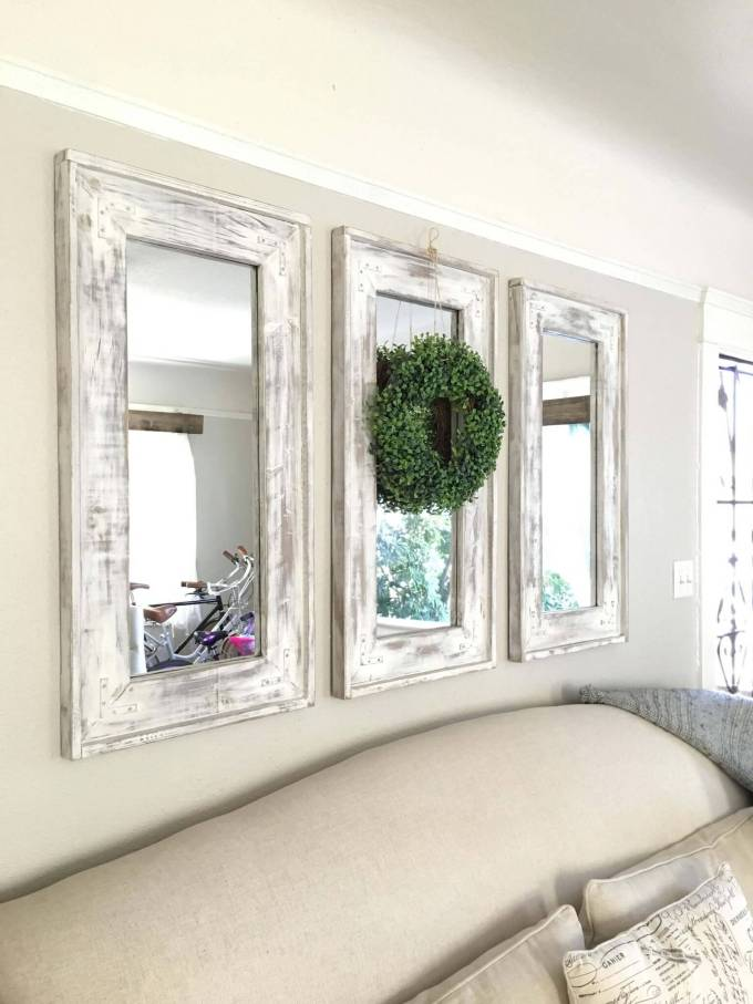 Farmhouse Kitchen Decor Design Ideas - Triad of Narrow Whitewashed Mirrors Accented with Eucalyptus Wreath - harpmagazine.com