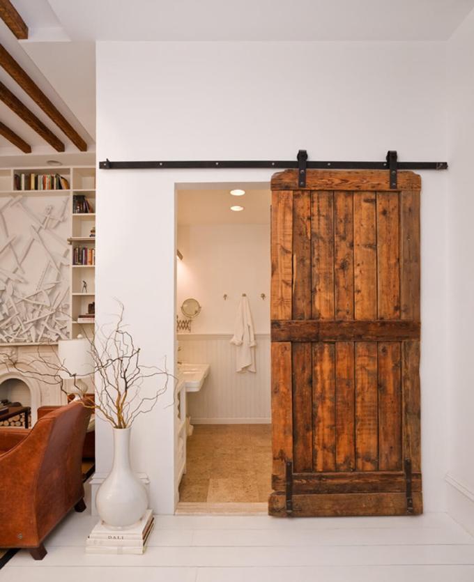 Rustic Bathroom Decor Ideas - Rolling Barn Door with Black Iron Hardware - harpmagazine.com