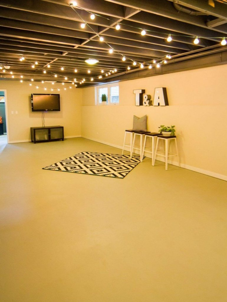 exposed basement ceiling ideas - 21. Add String Lights to Basement Ceiling - Harptimes.com