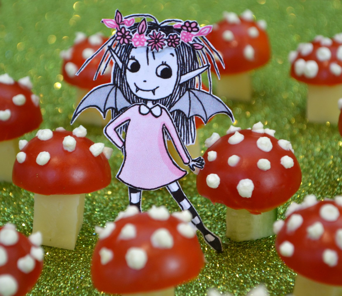 Isadora Moon posing with tomato and cheese toadstools