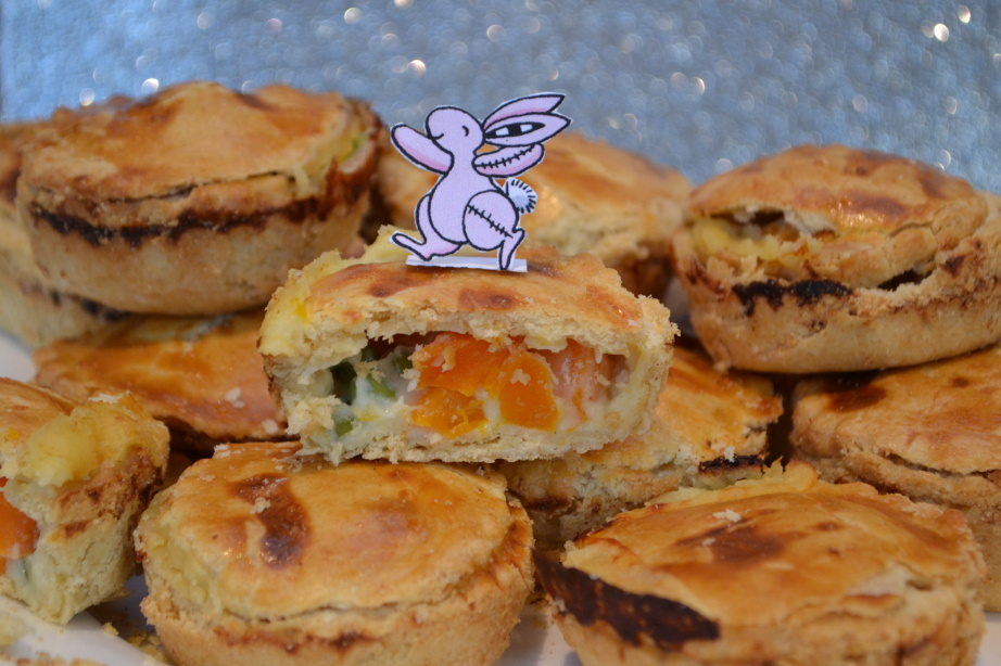 Pink Rabbit posing with his carrot and pea pies