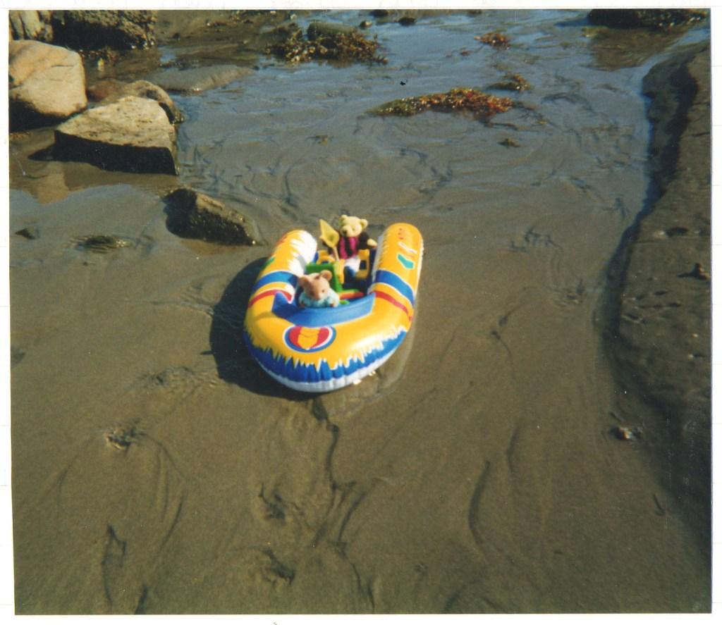Harriet Muncaster sending mascots down the stream in a boat