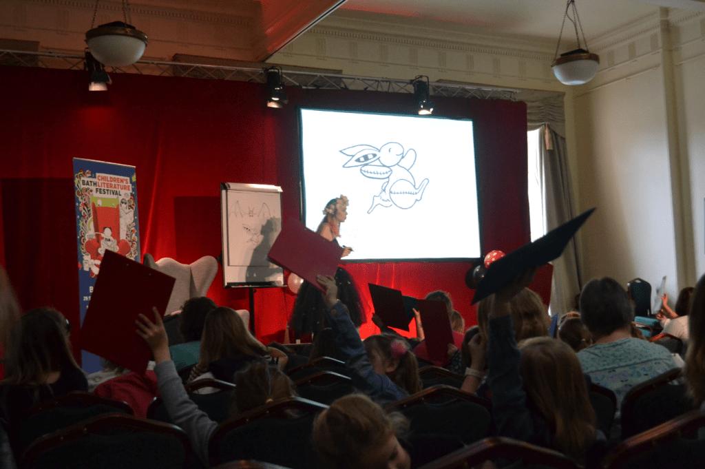 Harriet Muncaster performing an Isadora Moon event at Bath Children's Literature Festival