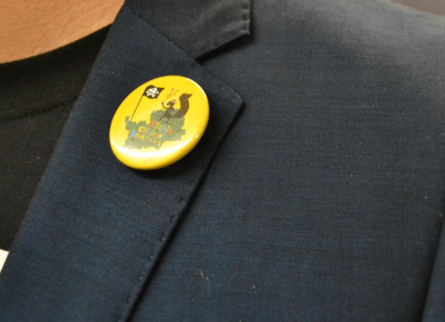 Danny Pearson sporting his Hitchin Children's Book Festival pin