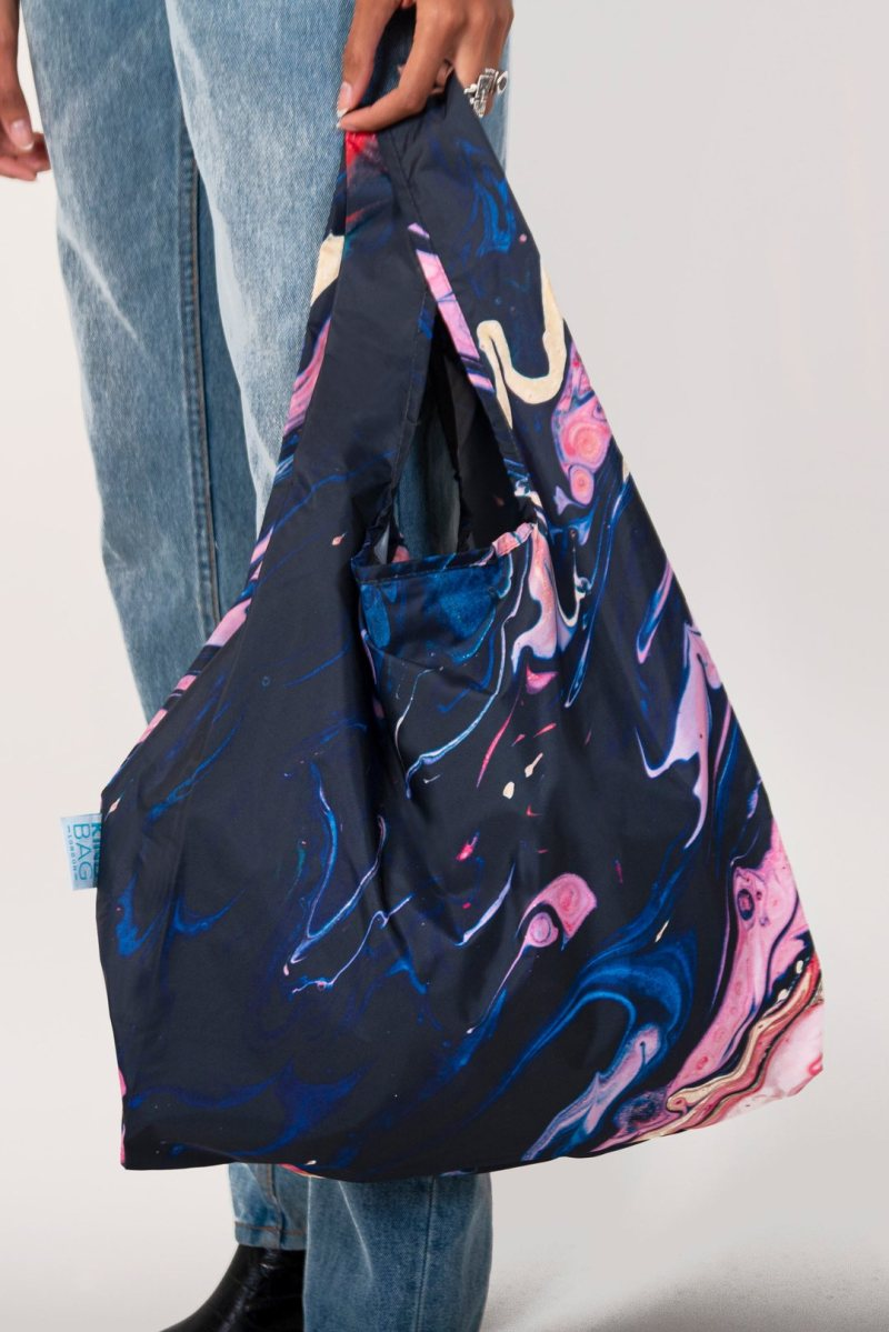 person holding kind bag galaxy design