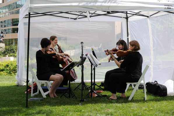 string-quartet-playing-at-outdoor-wedding-under-tent