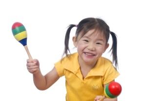 Little girl with maracas
