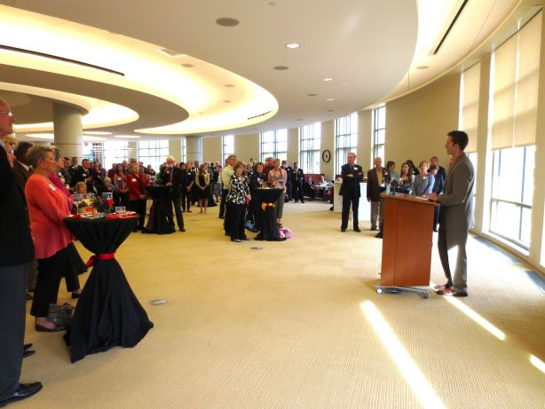Speaker addressing crowd at elegant fundraising event