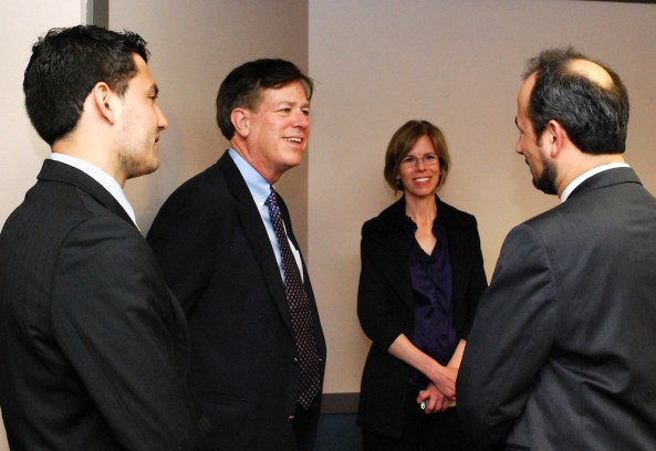 Harry meets with faculty and students at the Driehaus College of Business at DePaul University