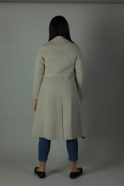 Luxury and warmth, the Cora Cashmere double-face coat is a non-compromiser. Any season, any occasion this iconic coat features 100% cashmere, collar ans waist belt for the perfect silhouette style. Back view.