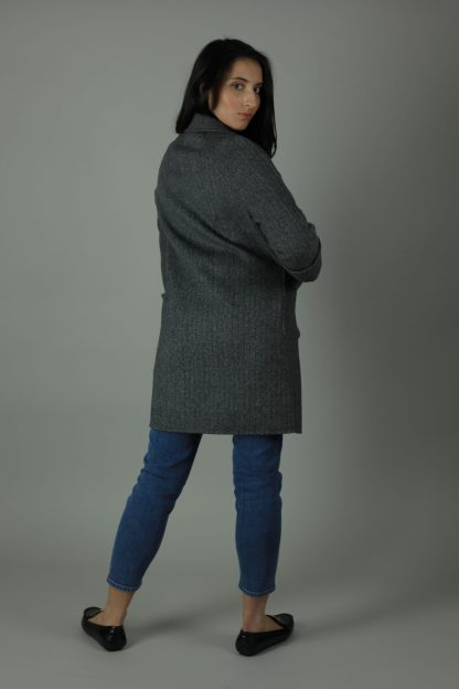 Luxurious style in the Ellie Cashmere double-face Coat for a year round look. Thigh length for casual wear, this coat features 100% Cashmere, loose fitting style and beautiful marble effect buttons. Back view.