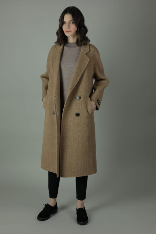 Luxurious practicality in The Handmade Dorothy Cashmere Coat, full length for casual, work or formal wear, this coat features 100% Cashmere, loose fitting style and beautiful cashmere interior for inside out look.
