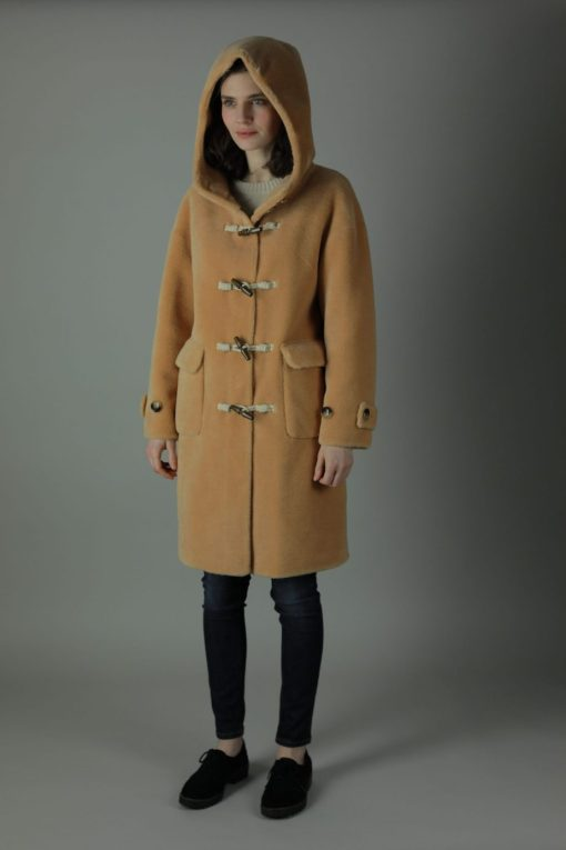 Decadence is everything in our 100% Shearling Daria Duffel coat, featuring wooden toggle buttons, spacious hood and patch pockets to recapture one of our winter favourites. Front view. Hood up.