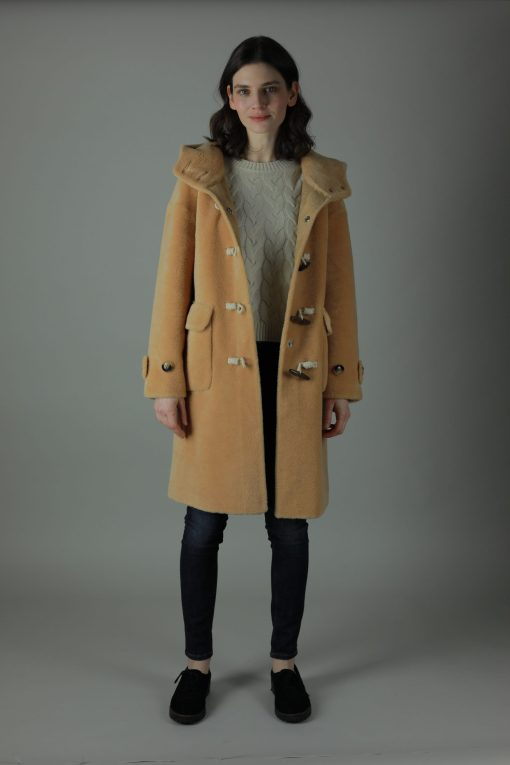 Decadence is everything in our 100% Shearling Daria Duffel coat, featuring wooden toggle buttons, spacious hood and patch pockets to recapture one of our winter favourites.