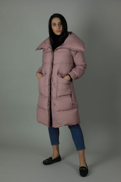 The Charlie Down Coat is perfect for the cooling weather. The Charlie is a high shine beautiful Down filled Nylon coat which features an ample hood and a detachable fur trim for style. The Charlie has a rich white exterior, deep cream contrasting interior, white and silver buttons and zip, two front exterior patch pockets and a interior breast pocket.