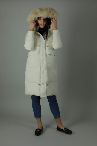 The Charlie Down Coat is perfect for the cooling weather. The Charlie is a high shine beautiful Down filled Nylon coat which features an ample hood and a detachable fur trim for style. The Charlie has a rich white exterior, deep cream contrasting interior, white and silver buttons and zip, two front exterior patch pockets and a interior breast pocket. Front view. Hood up.