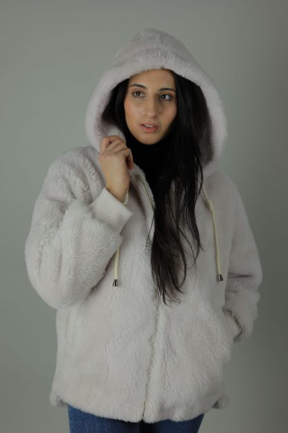 The Jen 100% Shearling lined Bomber is a year-round free-spirited favourite. Pair with anything, any time of the year to go casual or formal. With silver style accessories, two slit front pockets, interior breast pocket, an ample hood and fully lined interior this coat is designed for comfort, style and durability.
