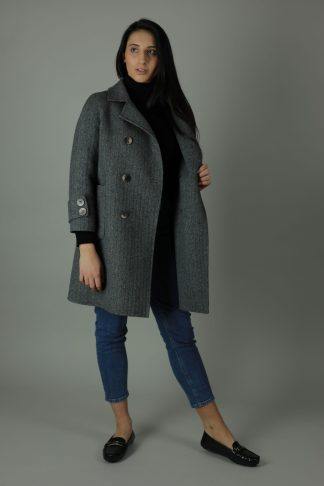 Luxurious style in the Ellie Cashmere double-face Coat for a year round look. Thigh length for casual wear, this coat features 100% Cashmere, loose fitting style and beautiful marble effect buttons. Front view.