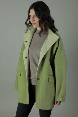 Luxury in The Chloe Cashmere Coat. Thigh length for all round wear, this coat features 100% soft Cashmere, loose fitting style, two front patch pockets and beautiful white soft cashmere interior for inside out look. Side view.