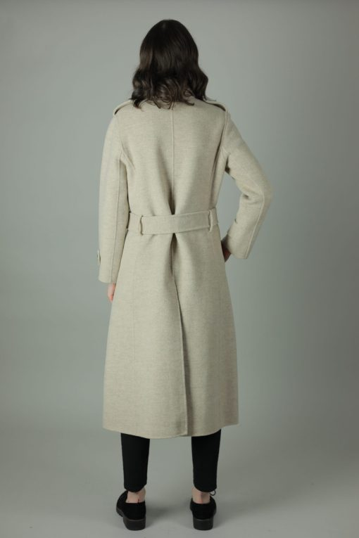 Luxury and warmth, the Alice Cashmere double wear coat is a non compromiser. Any season, any occasion this iconic style features 100% cashmere, back belt for silhouette and comes in two colours. Side view,