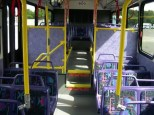 """The purple interior of a 2005-series bus. Another reason why I called these buses the """"Purple People Eaters""""! Also notice the """"Aquamarine"""" themed seating cushions."""