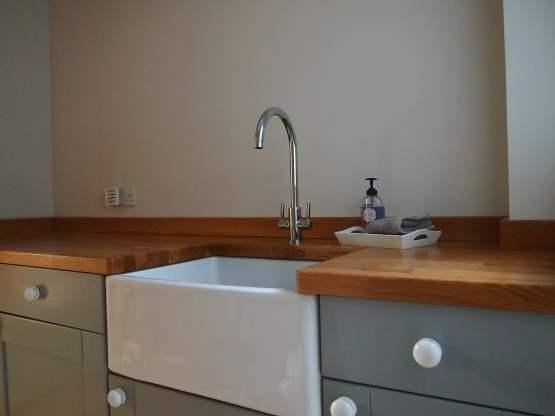 Oak worktop with Belfast sink cutout