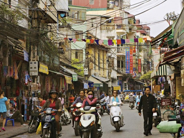 Hanoi's streets (in 2007, above) are now full of motorcycles and scooters, and shop shelves are no longer bare.