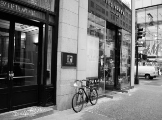 PC Week 6/2015 Submission: This was a random shot as I was walking down the street looking for prime numbers. The bike was really beat up and it stood out as it was propped up against the fashionable Ted Baker on Fifth Avenue. It was just my luck that the partial address in the next store front is a prime number. When I changed it to black and white, I really loved the over all composition and effect.