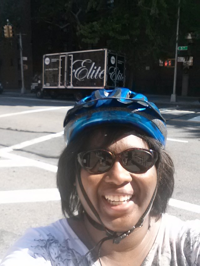 Me on moving day. The moving truck is behind me. I road my bike between the two apartments all that day.