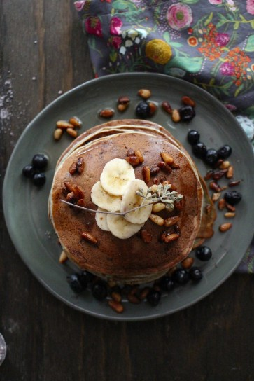 https://harvestandhoney.com/2015/05/13/blue-corn-blueberry-lime-pancakes-with-sugared-pine-nuts/