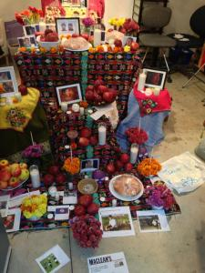 Mexican altar with flowers, candles, and photographs commemorating deceased migrant agricultural workers