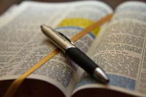 open_bible_with_pen