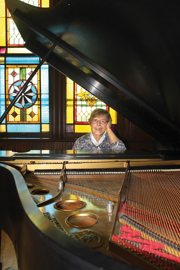 Norma Preheim majored in piano and music at Bethel College. Here, she sits at the grand piano in the Administration Building Chapel at Bethel College.