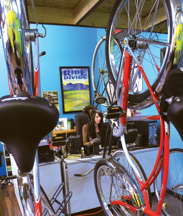 Newton Bike Shop owner Heather Barringer works at her desk during a winter afternoon. Photo by Wendy Nugent