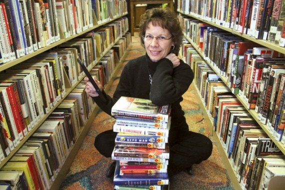 In her element at Newton Public Library, director Marianne Eichelberger has been director for more than 25 years. Photo by Wendy Nugent