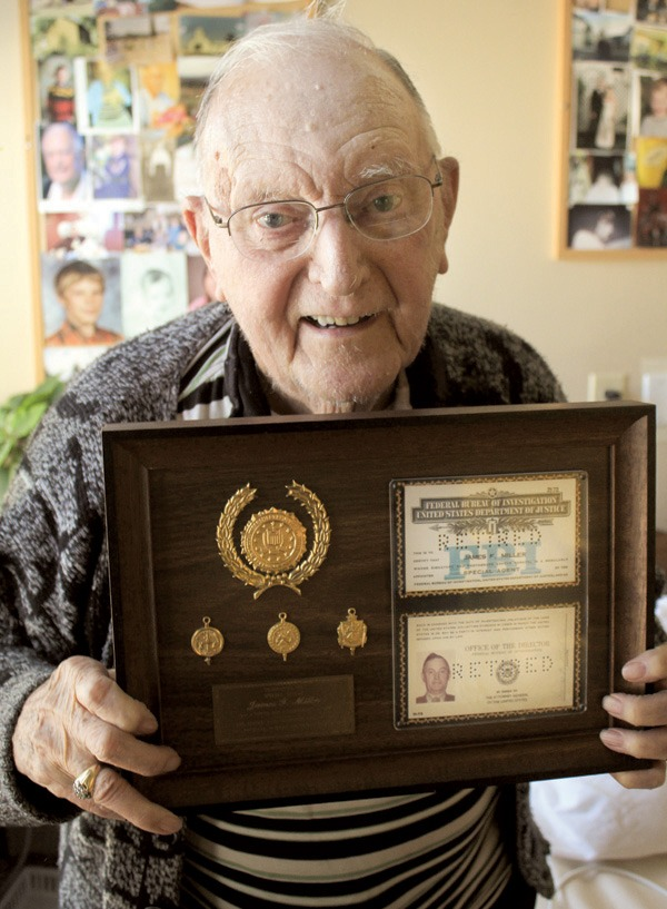 Asbury Park resident Jim Miller holds a plaque honoring his 29 years in the Federal Bureau of Investigation.