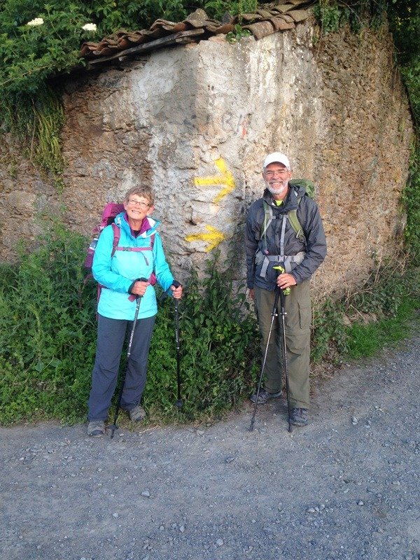 Keith and Judy Harder pause for a photo by a pair of yellow arrows marking the trail along the Camino de Santiago. The couple hiked more than 300 miles across Spain along the ancient pilgrimage route in April and May. Courtesy Photo
