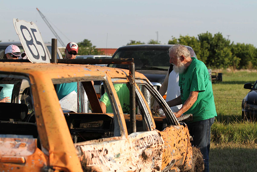 Chet Hartman talks with family after his demolition derby win. Hartman has been driving in demos since 1964.