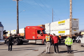 Gates come down, trapping semi-truck, causing train collision