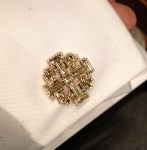 Jerusalem cross cuff links from his sponsor.