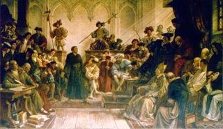 Bild: Luther vor Karl V. auf dem Reichstag zu Worms 1521. Wandgemälde (um 1880) von Hermann Wislicenus in der Kaiserpfalz Goslar. Dieses Bild ist gemeinfrei, weil seine urheberrechtliche Schutzfrist abgelaufen ist.