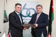 اتفاقية بين البنك الاهلي و البلقاء التطبيقية  لتطبيق نظام البطاقات الذكية