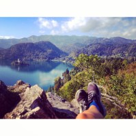 Atop a rock, looking out over Lake Bled