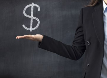 Woman holding dollar sign