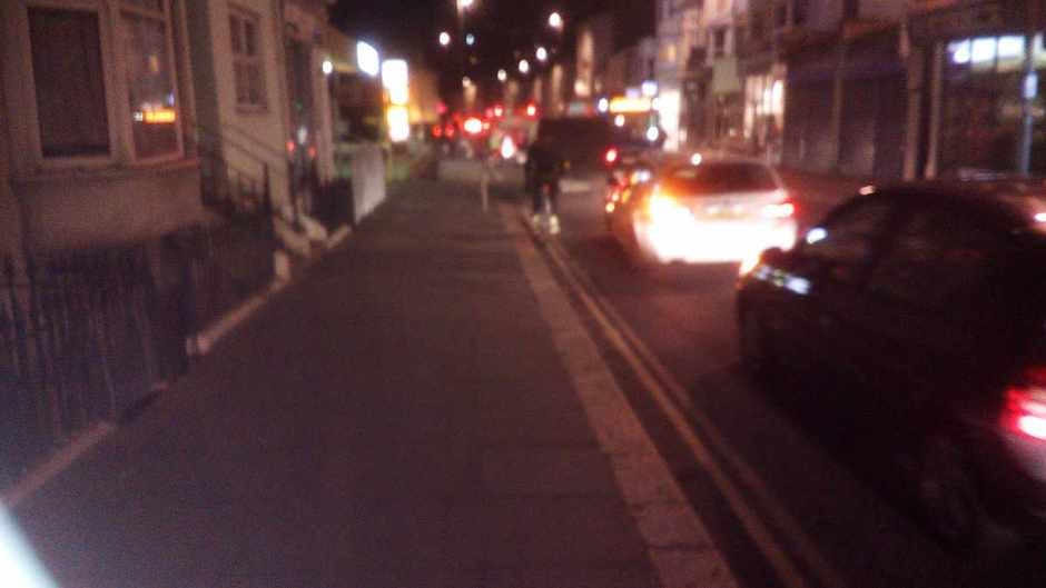 Road cyclist with no lights, Queens Road, Hastings